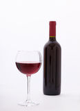 Glass and bottle of red wine unusually on white Stock Photography