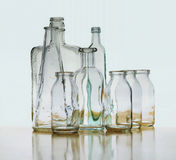 Glass bottle refraction, reflection floating on horizon Royalty Free Stock Photos