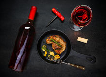 Glass and Bottle Rose Wine with Grilled Steak Royalty Free Stock Images