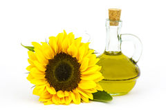 Glass bottle with sunflower oil and sunflower Royalty Free Stock Photography