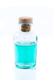 Glass bottle of turquoise blue liquid Stock Photos