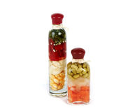Glass bottle with vegetables. Red yellow stock image