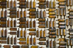 Glass bottle wall Stock Photography