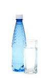 Glass and bottle of water isolated. On white Royalty Free Stock Photo
