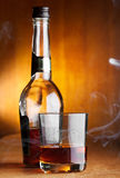 Glass and bottle of whiskey Royalty Free Stock Photos