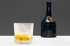 Glass and bottle of whiskey Royalty Free Stock Image