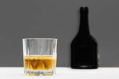 Glass and bottle of whiskey Royalty Free Stock Photo