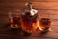 Glass and bottle with whiskey Stock Photography