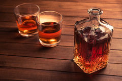 Glass and bottle with whiskey Royalty Free Stock Photo