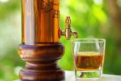 Glass and bottle of whisky. With bar in deep Stock Photo