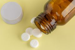 Glass bottle of white pills Stock Image