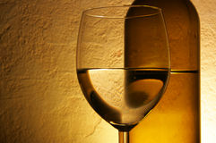 Glass and bottle of white wine Stock Photo