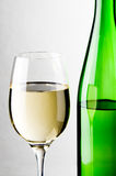 Glass and bottle of white wine Royalty Free Stock Images