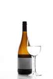 Glass and bottle of white wine Stock Image