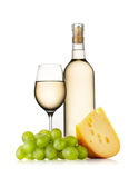 Glass and bottle of white wine with cheese Royalty Free Stock Photo
