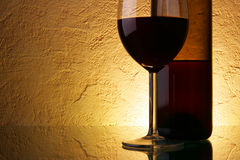 Glass and bottle with wine Stock Photos