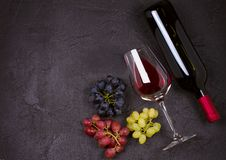 Glass and bottle of wine with grapes. Wineglasses, drinks concept. Stock Photography