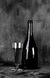 Glass and bottle with wine Royalty Free Stock Photos
