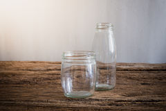 Glass bottle on wooden tabletop Stock Image