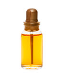 Glass bottle with yellow liquid Stock Photography