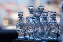 Glass bottles. Shallow DOF, focus on central bottles Royalty Free Stock Photos
