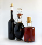 Glass bottles with balsamic vinegar. Ion white stock photography