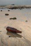 Glass bottles on the beach, Trash. On sunset Stock Photos
