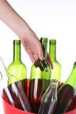 Glass bottles in bin Royalty Free Stock Image