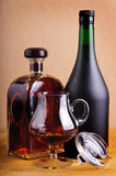 Glass and bottles of brandy Royalty Free Stock Photography