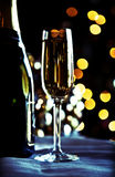 Glass and bottles of champagne. With Christmas background stock photo