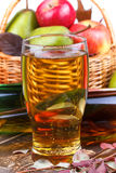 Glass and bottles of cider, fruits basket Royalty Free Stock Images