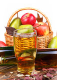 Glass and bottles of cider, fruits basket Royalty Free Stock Photography