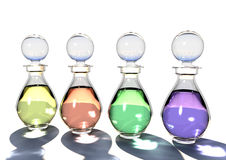 Glass Bottles with coloured oils. A range of delicate glass bottles with different coloured oils Stock Photography