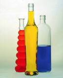 glass bottles filled with colored liquids Stock Photo