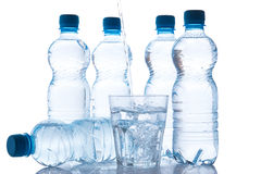 Glass and bottles with fresh water Royalty Free Stock Photography
