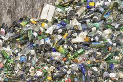Glass bottles at garbage disposal. June, 2018 -A pile of empty glass bottles at garbage disposal, waste sorting and management concept royalty free stock photos