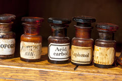 Glass bottles in historical pharmacy Stock Image