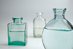 Glass bottles I. Still life with water and glass stock photos