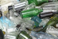 Glass bottles inside a glass recycling. Container Royalty Free Stock Photos