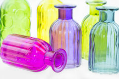 Glass bottles isolated on white background, Colorful glass set on white background, Glass for fresh water, Vintage glass set Stock Images