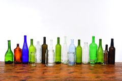 Glass bottles and jars on top of a wooden table stock photo