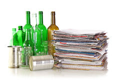 Glass bottles, metal cans and newspapers Stock Photo