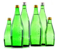 Glass bottles of mineral water isolated on white Stock Photo