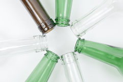 Glass bottles of mixed colors including green, clear white, brow Royalty Free Stock Photos