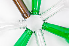 Glass bottles of mixed colors including green, clear white, brow Stock Photos