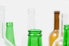 Glass bottles of mixed colors including green, clear white, brow Royalty Free Stock Photography