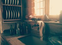 Glass Bottles Near Sink With White Towel Royalty Free Stock Photos