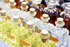 Glass bottles with oil. And liquids royalty free stock photos