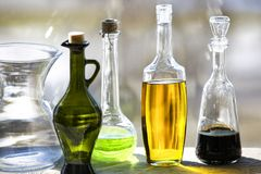 Glass bottles and vase on the window background stock image
