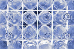 Glass bottles. In plastic crate Royalty Free Stock Photos